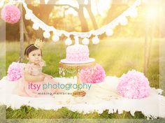 outdoor field photography cake smash photos posing ideas pink and gold colors