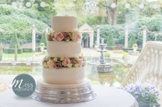 Wedding cake with fresh flower separators by Arcade Flowers Ringwood