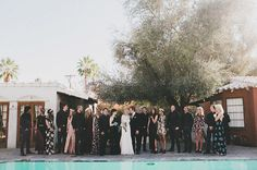 Super chic boho wedding in Palm Springs. Obsessed with these different patterned bridesmaids dresses all within the same black, white and pink color palette.