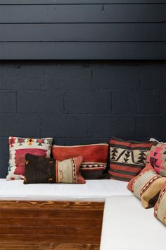 Cushions in orange and pink shades and geometric patterns