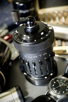 Curta Calculator, a mechanical calculator that pre-dated the popularization of the transistor. This example was produced in 1953.