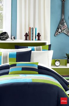 Navy with a twist of lime. Transitioning into a different color scheme with this bold, color-blocked comforter will help your dude feel comfortable and cool.