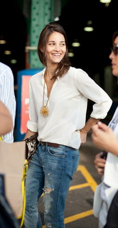 How to wear a statement pendant necklace: Pair back to a neutral solid top and your favorite denim