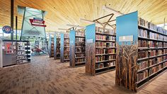 Patience Latting Northwest Library, Oklahoma City, emphasizing its cornstalk and oil well heritage in stunning stack end panels and a majestic separation between the stacks and the quiet reading area