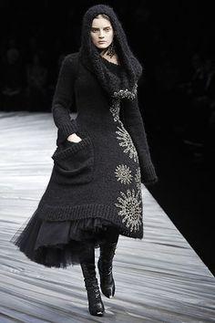 black knit sweater dress w/ tulle underlay   hooded, single large pocket, asymmetrical silver star like embroidery details    Alexander McQueen Fall 2008 RTW