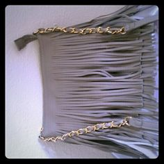 New (never used) - Light gray fringed crossbody with shoulder strap. Brand new. Serious inquiries and cash only. Thanks