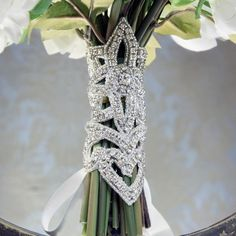 Add a little bling to your bridal bouquet with this very opulent adjustable wrap with ribbon lacing.You can pick either white or ivory ribbon.