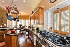 kitchen-really like the counter space between the stove and the window, for large pots and pans---1628 Pembroke Ln, McKinney, TX 75070