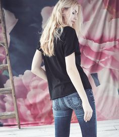 Keep it casual in a black tee and faded denim.