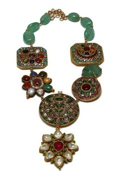 Indian necklace. Navratna that is 9 gems where ruby is always placed in the centre. Stringed in emeralds.