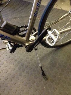 Titanium frame, Shimano Di2, and a propstand, dear god why.
