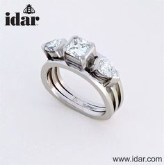 Idar - Handmade, three stone ring in platinum.  Two carats total weight.