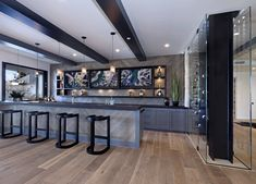 Frameless glass enclosure wine room ideas The two-story frameless glass enclosure wine room continues from the kitchen to the lower level Basement Bar Designs, Basement Ideas, Basement Bars, Basement Ceilings, Basement Laundry, Ultra Modern Homes, Basement Bedrooms, California Homes, Basement Remodeling