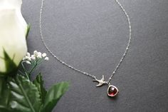 Bird Carry Ruby Faceted Triangle Glass Stone by emilymoon2003, $25.00