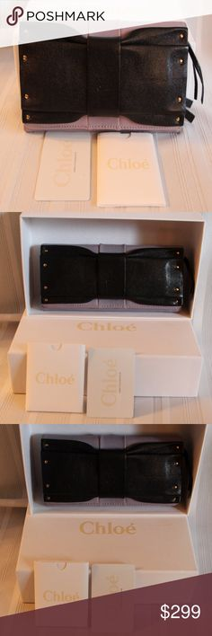 """Chloé June bow-embellished leather wallet Brand new with tags and box! Gorgeous exquisite lilac and black leather genuine Chloe! Approx  Measurements :  7.5"""" X  4"""" 12 card slots two bill compartments and zippered change back outside All of my items are Guaranteed 100% Genuine I do not sell FAKES of any kind! NO TRADES (03S096 Chloe Bags Wallets"""