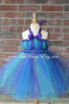 making this for Madeline's halloween costume... she is going to be a peacock