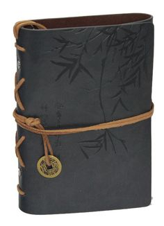 Beautiful embossed Bamboo Design Genuine leather journal, antique-style coin ornament and interior metal binder with accompanying blank paper. Features pages made entirely from recycled fabric and bio