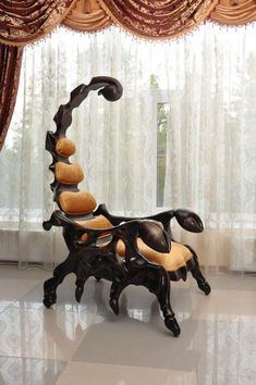 The fearsome Scorpion Chair is a handcrafted wooden chair that is shaped like a scorpion. The chair measures in at six and a half feet and is available with leather upholstery and a variety of wood. Awsome design different and looks solid. Funky Furniture, Unique Furniture, Furniture Design, Distressed Furniture, Farmhouse Furniture, Furniture Stores, Cheap Furniture, Pallet Furniture, Custom Furniture