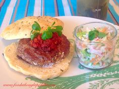Chèvre-stuffed lamburgers with sun dried tomatoes-tahini pesto on gluten free flatbread and radish coleslaw with poppy seed yogurt dressing