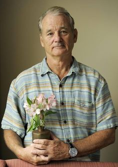 Here is Bill Murray holding a pot of flowers