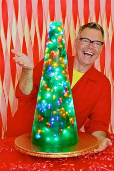 LIGHT UP JELLO CHRISTMAS TREE 2013 !!! … Traffic cone as mold … losta Knox Gelitan … green food coloring … several stands of LEDs wrapped around a foil covered styrofoam cone !!!