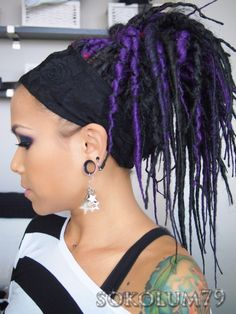 i have always wanted dreads! Hers are pretty cool, black and purple.