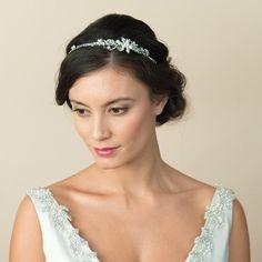 Model bride with an informal bun up do hair style wearing Antonia Bridal Side Tiara