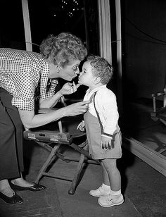 Lucy gives little Desi, Jr. a kiss....cute.