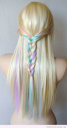 Pastel color highlights on blonde hair color in a braid