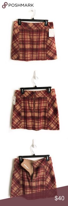 New Plaid Free People Skirt New Free People Skirt. Great Quality. Material: Wool/Polyester. Size Medium (8). Laying flat waist measures 15.5 inch, length 16 inch (see last picture) 🚫No Trades🚫No Modeling Photos. Free People Skirts Mini