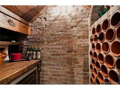12290 Colliers Reserve Dr, Naples, FL | Rustic wine cellar - brick wall.  Colliers Reserve Golf and Country Club