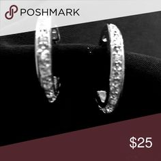 Classy silver hoop earrings Classy, sterling silver hoop earrings with CZ going from post to very back.  It was very difficult to get a clear picture to see the detail.  They are about the size of a nickel. Jewelry Earrings
