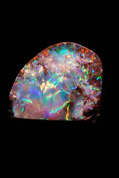 I'm in love with opal. Honestly I'd rather have that in my wedding ring than diamonds.