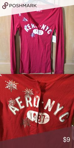 NWT! Aeropostale tshirt NWT! Never been warn, size M. Red long sleeve Aeropostale tshirt with Aeropostale on the front and some decorative snowflakes and buttons, super comfy and cute! Smoke/pet free home. Super deal! Aeropostale Tops Button Down Shirts