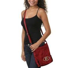NFL Washington Redskins Grommet Cross Body Purse, 8.5 x 2 x 7.5-Inch, Red by LittlEarth. $34.00. This team-colored nylon bag features cool grommet detailing on the side, a domed team logo on the front, a durable, across-the-body adjustable strap for comfort and multiple interior pockets so you can carry this bag while running errands or cheering on your team to victory.