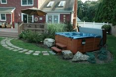 Best Hot Tubs is your local hot tub store and spa expert on Long Island, in New York, and surrounding states. Visit your nearest Best Hot Tub store today! Hot Tub Backyard, Backyard Water Feature, Small Backyard Pools, Hot Tub Surround, Hot Tub Accessories, Small Water Features, Hot Tubs, Backyard Projects, Backyard Ideas