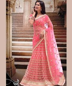 Buy Pink Net Wedding Lehenga Choli 76068 online at best price from vast collection of Lehenga Choli and Chaniya Choli at Indianclothstore.com.