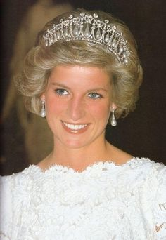 Lovely Diana sparkles in white gown