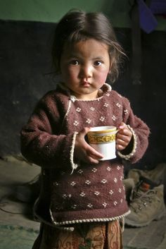 Ladakh Child Enjoying A Cuppa..