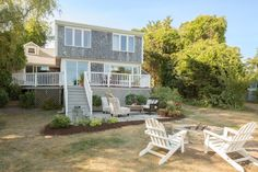This Cape Cod home now features everything you could want in a relaxing vacation spot, including comfortable outdoor seating and a brand-new firepit.