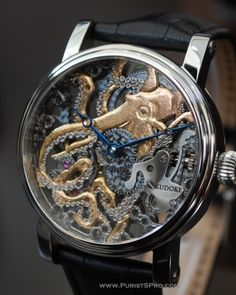 Kudoke octopus watch. Really neat to look at, but very difficult to read the time. Needs hands to be more visible.