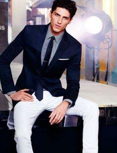 Men's Navy Blazer, Navy Silk Tie, White Jeans, Light Blue Dress Shirt, and White Pocket Square
