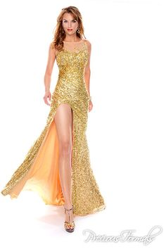 3f927c882980e Precious Formals Style This elegant slitted sequined red carpet style  features a sheer high neckline, keyhole back and golden beaded starburst.