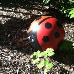 Lady bug yard art made from a bowling ball.