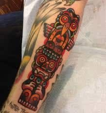 What does totem tattoo mean? We have totem tattoo ideas, designs, symbolism and we explain the meaning behind the tattoo. Lion Tattoo Design, Tattoo Designs Men, Totem Pole Tattoo, Hand Tattoos, Sleeve Tattoos, Dr Woo Tattoo, Medieval Tattoo, Statue Tattoo, American Indian Tattoos