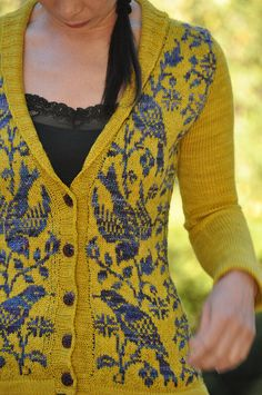 Ochre yellow and blue bird/flower knitted cardigan.