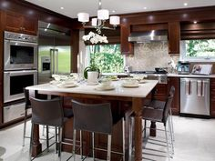 Wood kitchen cabinets-stainless steel-island-backsplash