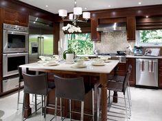 Wood kitchen cabinets-stainless steel-island-backsplash