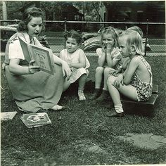 Woman reading to children outside, The University of Iowa, May 28, 1941 (by The University of Iowa Libraries)