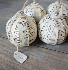 Sheet music ornaments. Love the button and beads at the top.